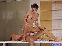 Masseuse Kate Rich gives a table handjob before she's oiled plus fucked