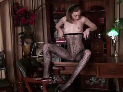 Small tits model Katie White moans while playing on the table
