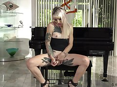 Horny blonde shemale Lena Kelly looks good in black lingerie during solo