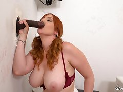 Plain vanilla oral and pussy action through the glory hole on the top of a BBC
