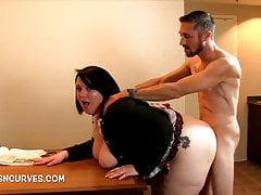 Secretary bent over a desk