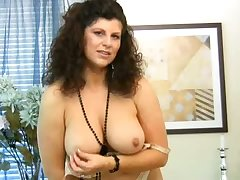 Curly mature unspecific with huge titties Gilly masturbates herself