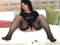 Buxom mature MILF in silky underwear Isadora M. masturbates