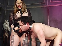 Insensible to Domme introduces her slave to her huge phallus