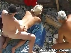 Spoiled amateur blonde GF flashes booty shafting doggy on an obstacle beach